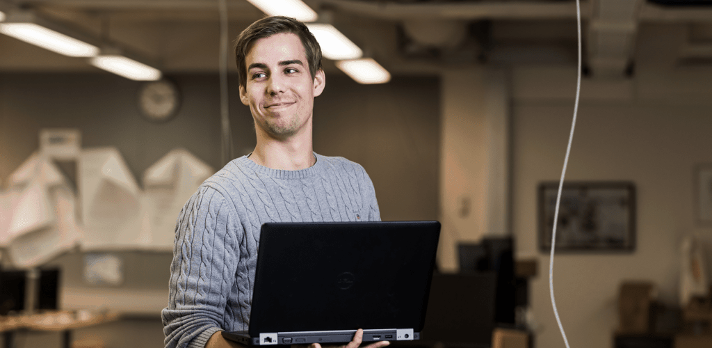 Data center professional smiling and being professional
